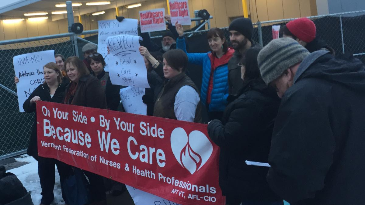 UVM Medical Center staff and community members rally outside of UVM Medical Center